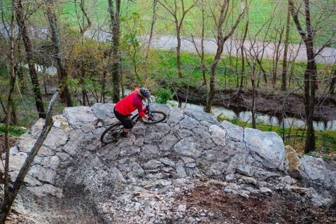 biker on rock berm rock solid
